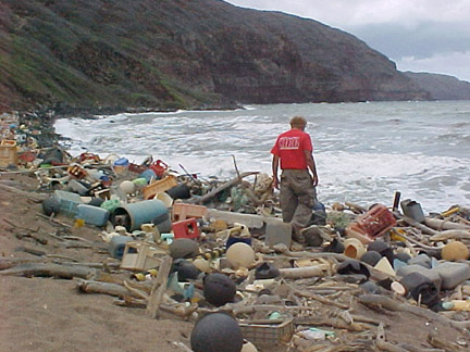 Photo of plastic marine debris all over a Hawaiian coastline - via Wikimedia Commons