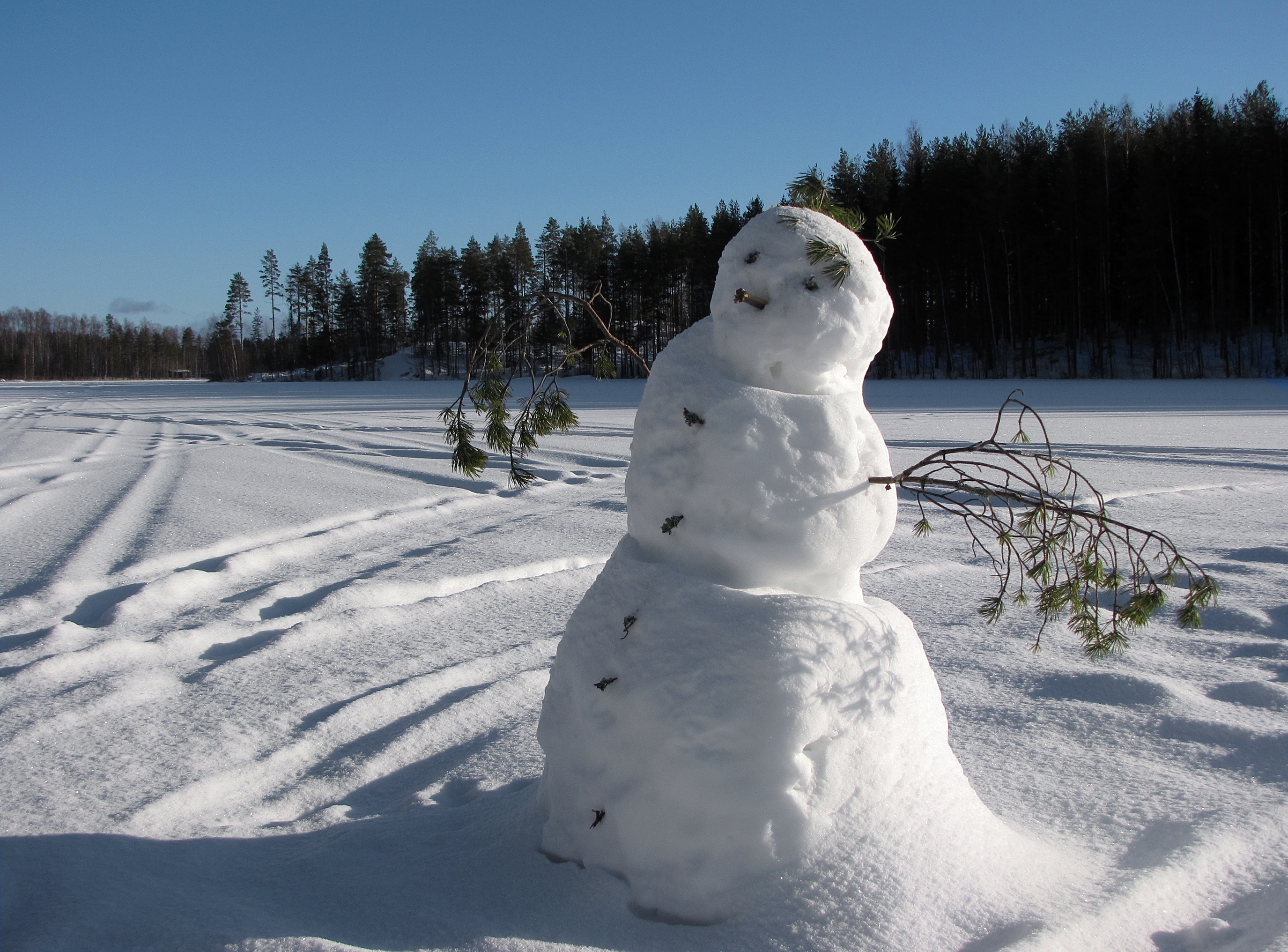 Snowman on frozen lake