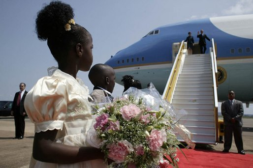 President George W. Bush and Mrs. Laura Bush arrive in Entebbe, Uganda Friday, July 11, 2003.