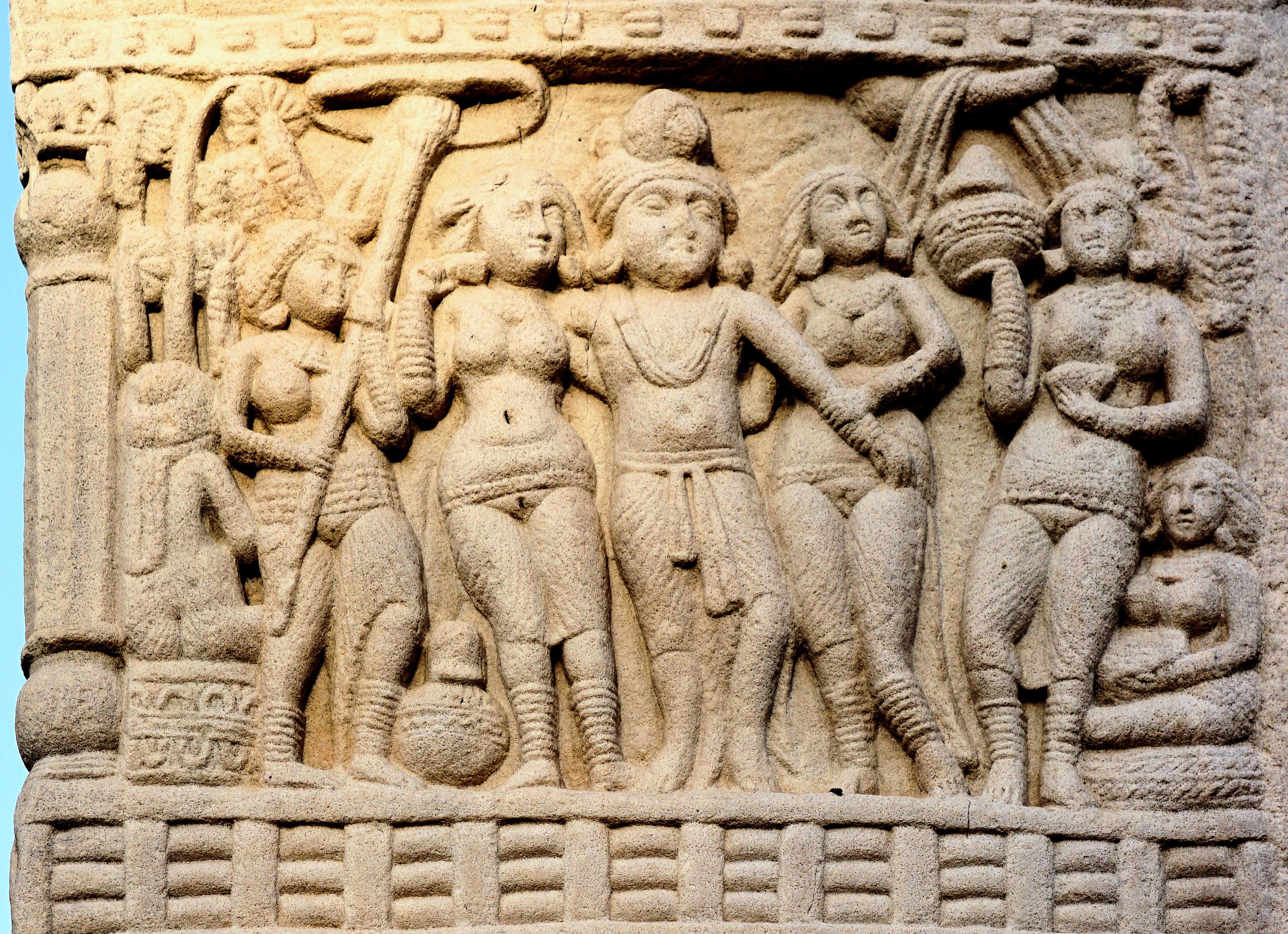 https://upload.wikimedia.org/wikipedia/commons/b/b4/Sanchi_King_Ashoka_with_his_Queens%2C_South_Gate%2C_Stupa_no._1.jpg