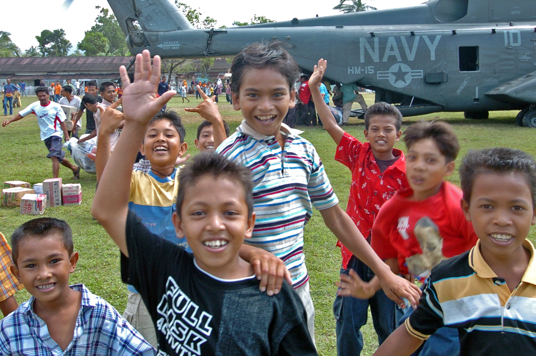Navy 050123 n 9885m 136 indonesian children gather around a mh 53e sea