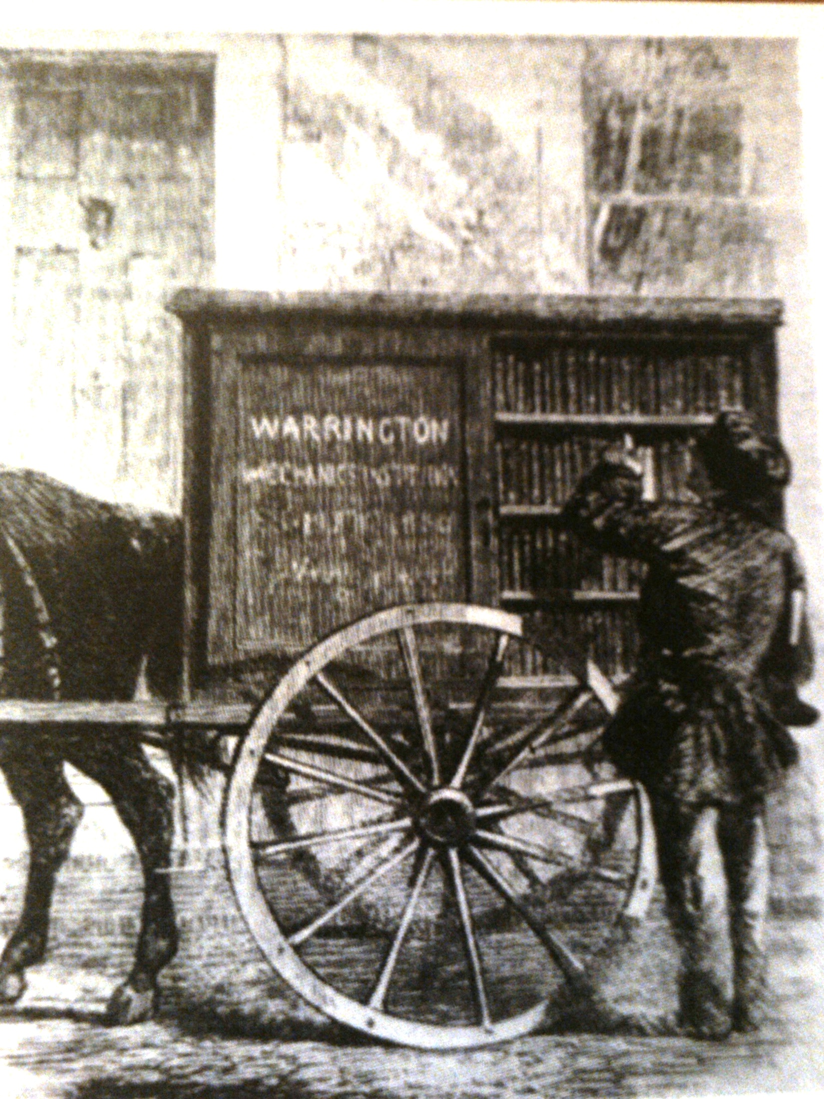 Book cabinet on horse-drawn cart