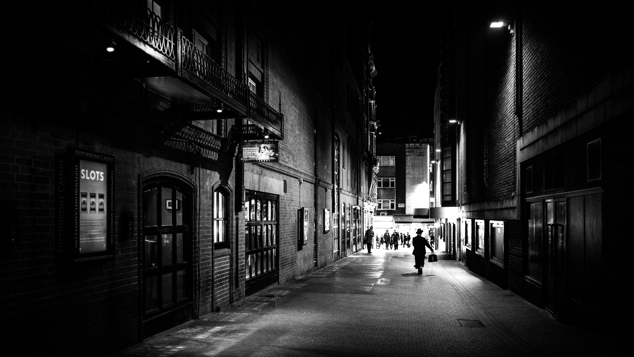 Filea man walking at night london england black and white street photography 182917619