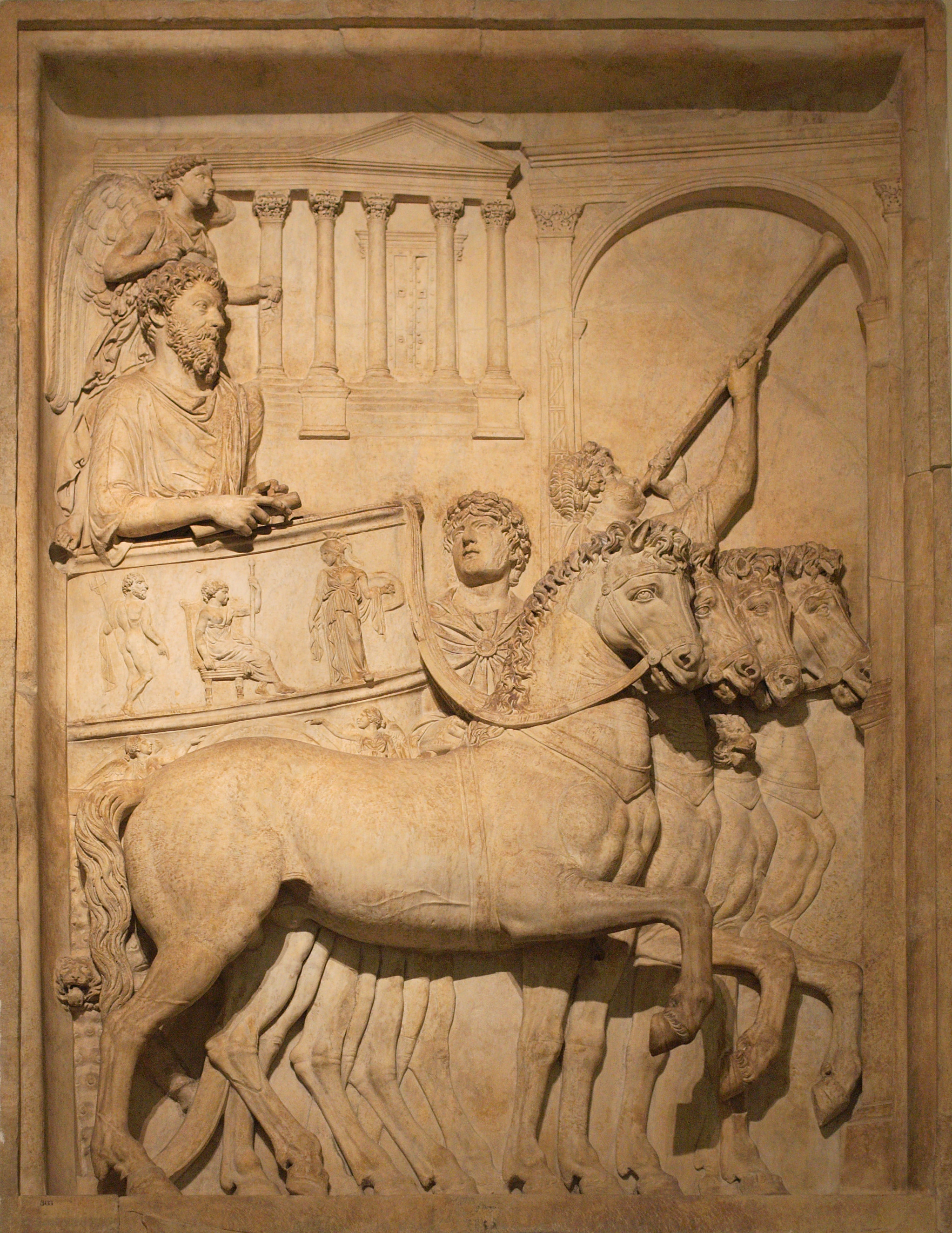 https://upload.wikimedia.org/wikipedia/commons/b/b5/Bas_relief_from_Arch_of_Marcus_Aurelius_triumph_chariot.jpg
