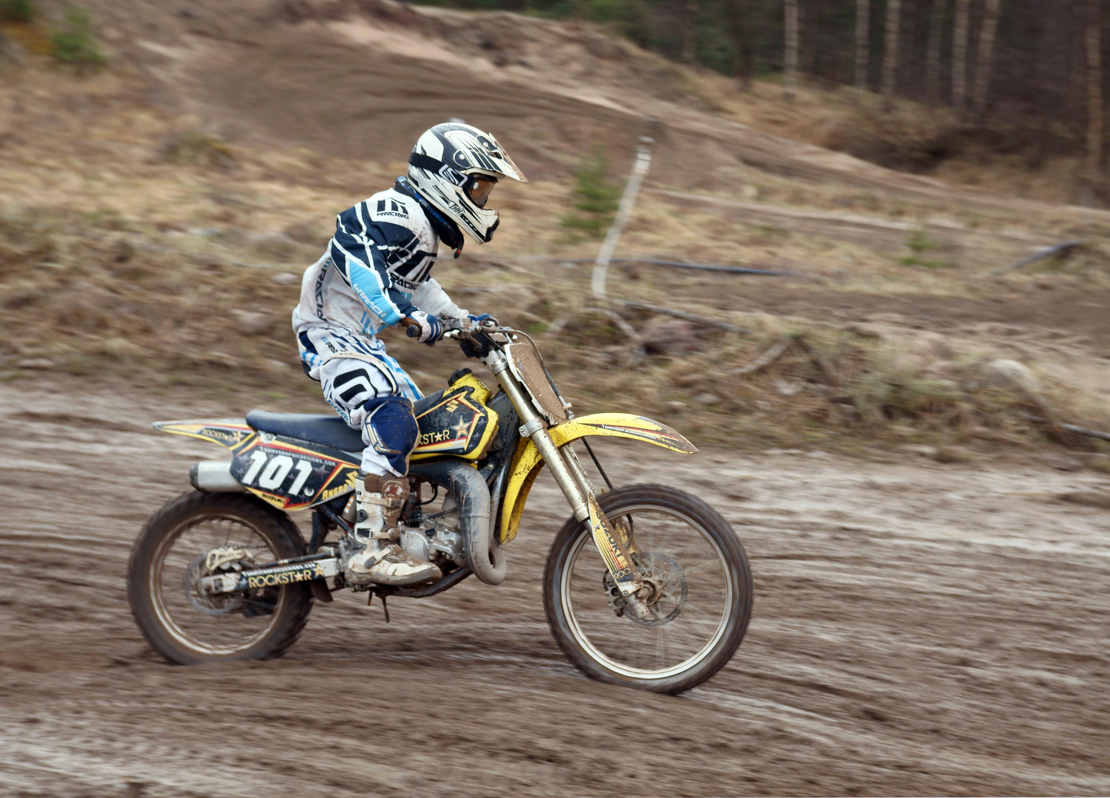 Motocross rider heading right