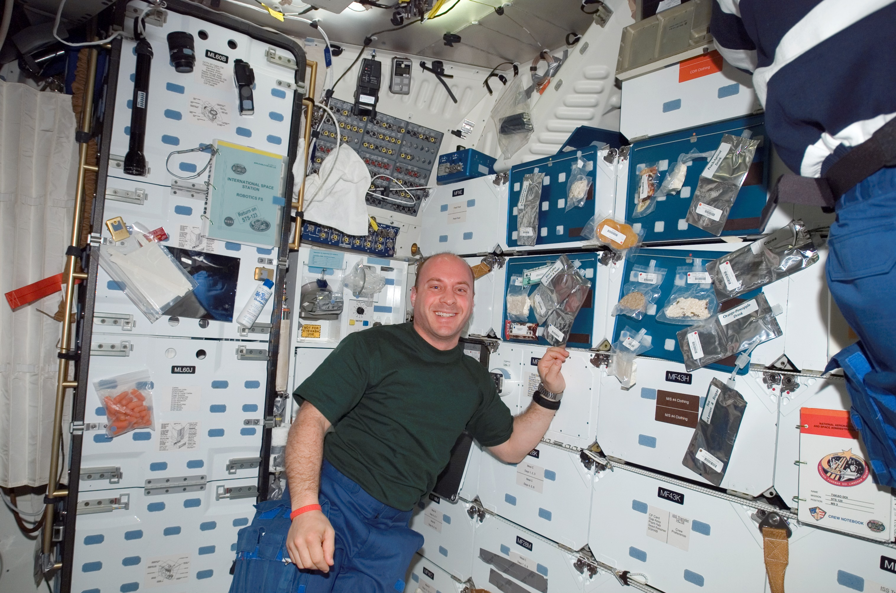 Garrett Reisman on the mid-deck of Space Shuttle Endeavour during STS-123. Reisman aboard Endeavour.jpg