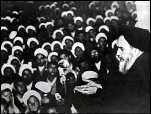 Grand Ayatollah Ruhollah Khomeini in Qom, 1964 Ruhollah Khomeini speaking to his followers against capitulation day 1964.jpg