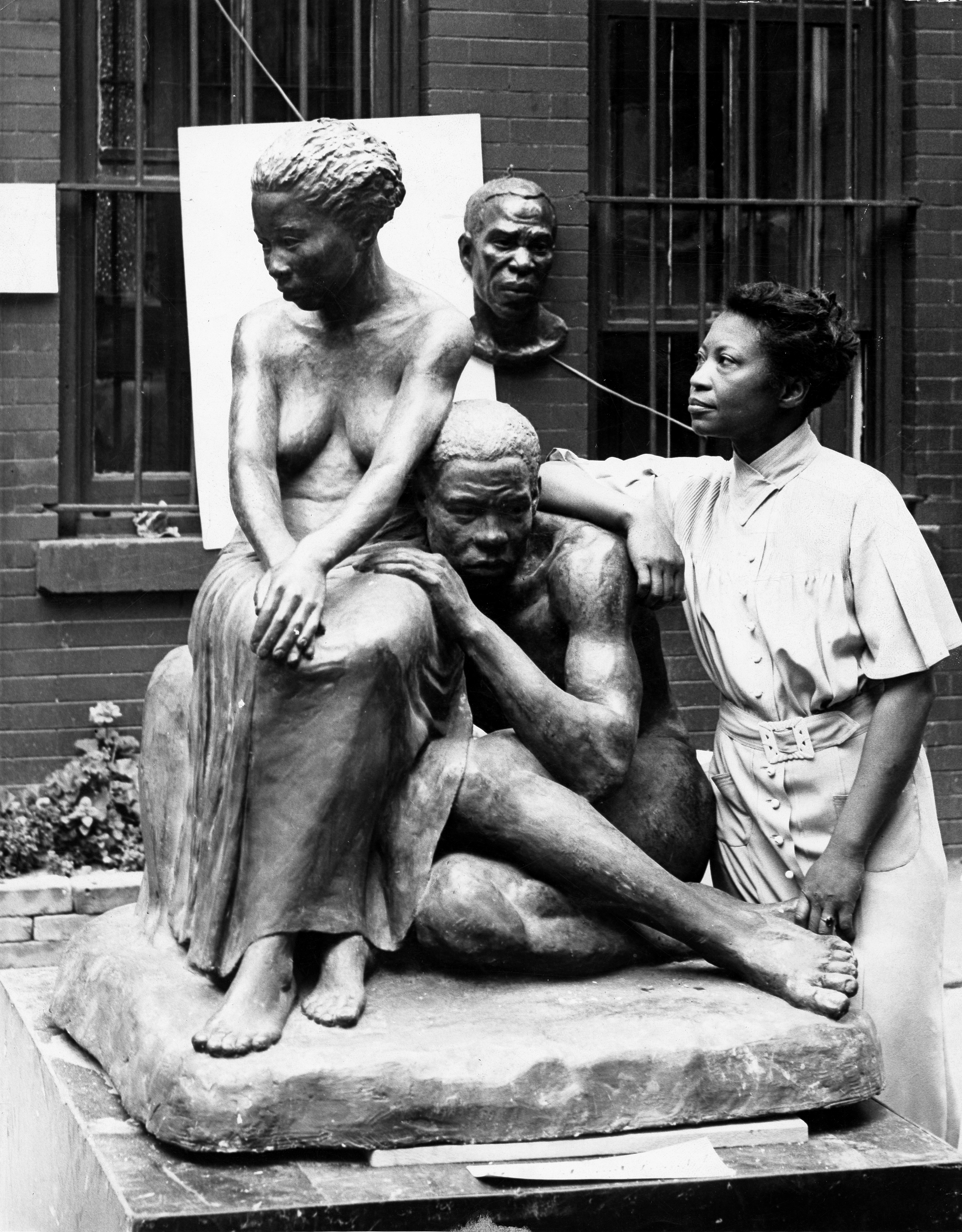 Augusta Savage with one of her sculptures, ca. 1938. From the collection of the [[Archives of American Art]]
