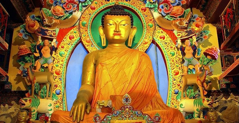 Buddhism is practiced by 13% of the population. Shown here is a statue of the Buddha in Tawang, Arunachal Pradesh.