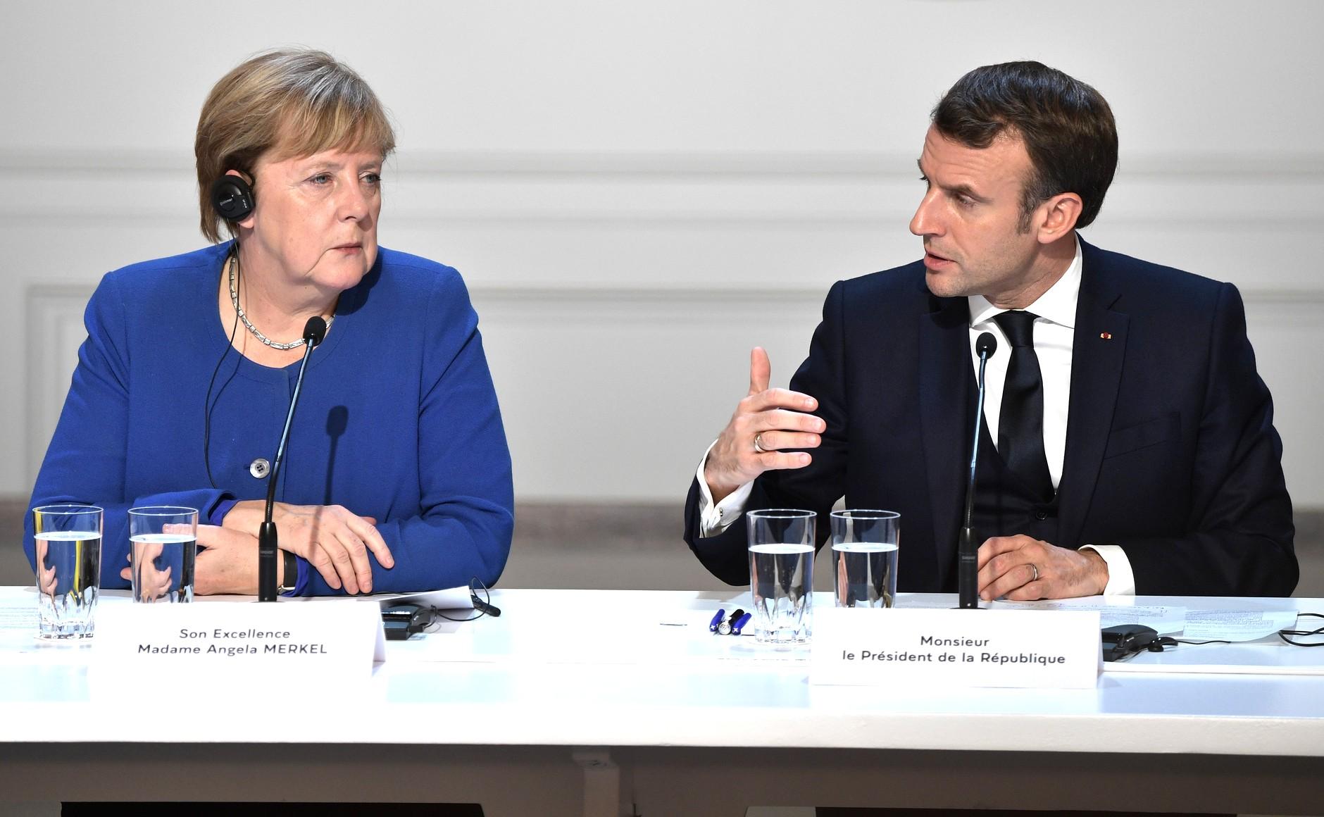 File:Emmanuel Macron and Angela Merkel (2019-12-10).jpg - Wikimedia Commons