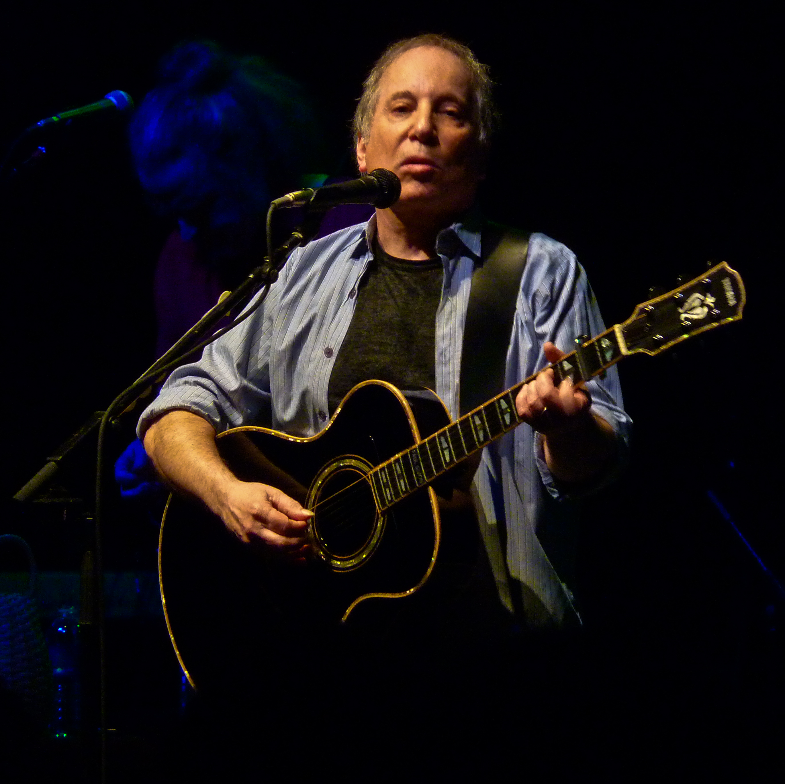 Simon performing at the [[9:30 Club]] on May 27, 2011
