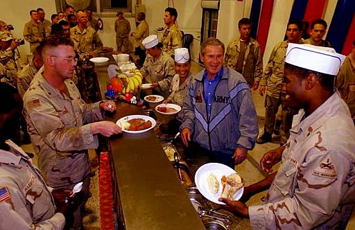 U.S. President George W. Bush with U.S. troops at the Bob Hope Dining Facility on Thanksgiving 2003 at Baghdad airport.