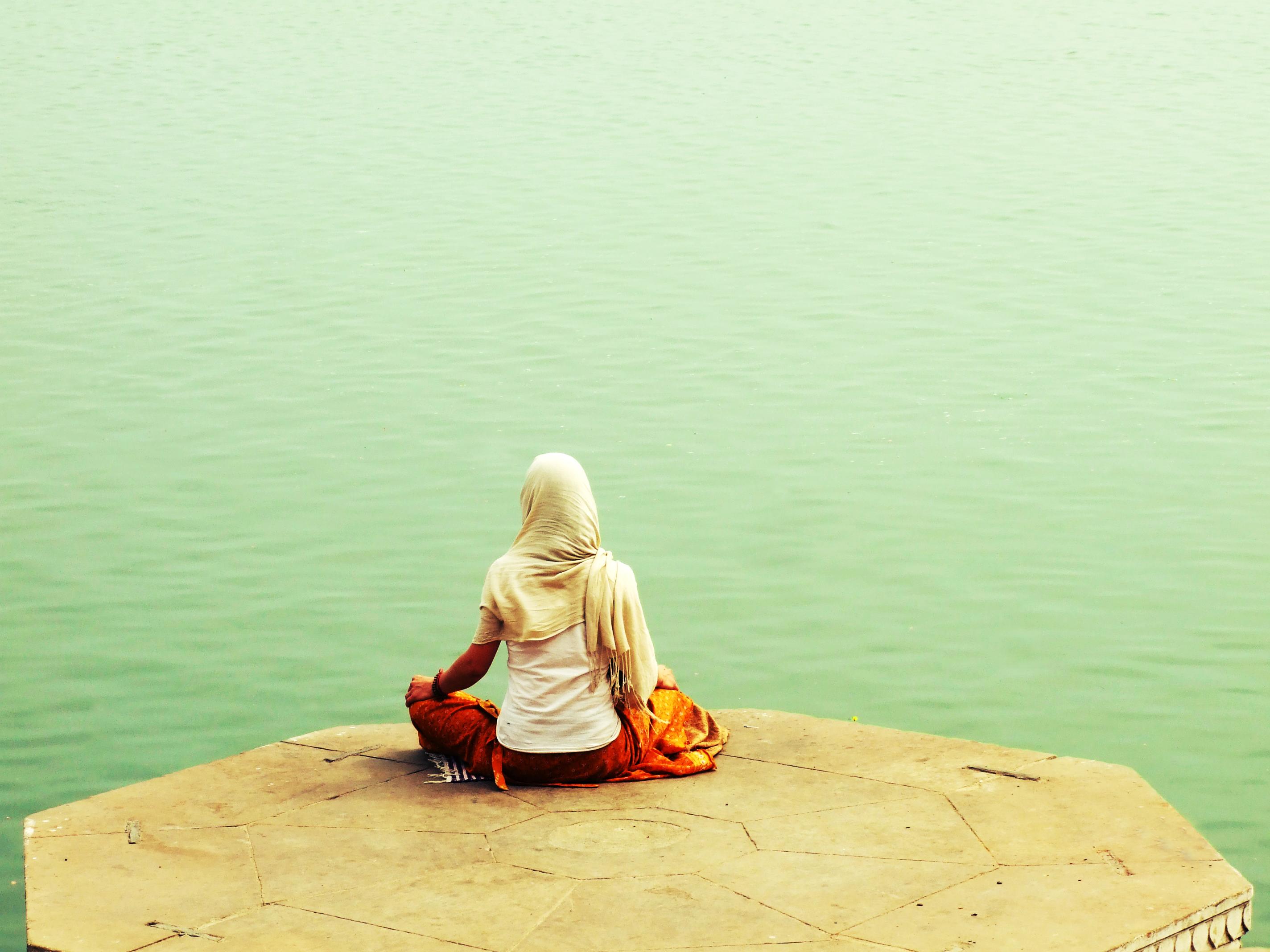 File A Hindu Along River Ganges In Varanasi In Yoga Asana