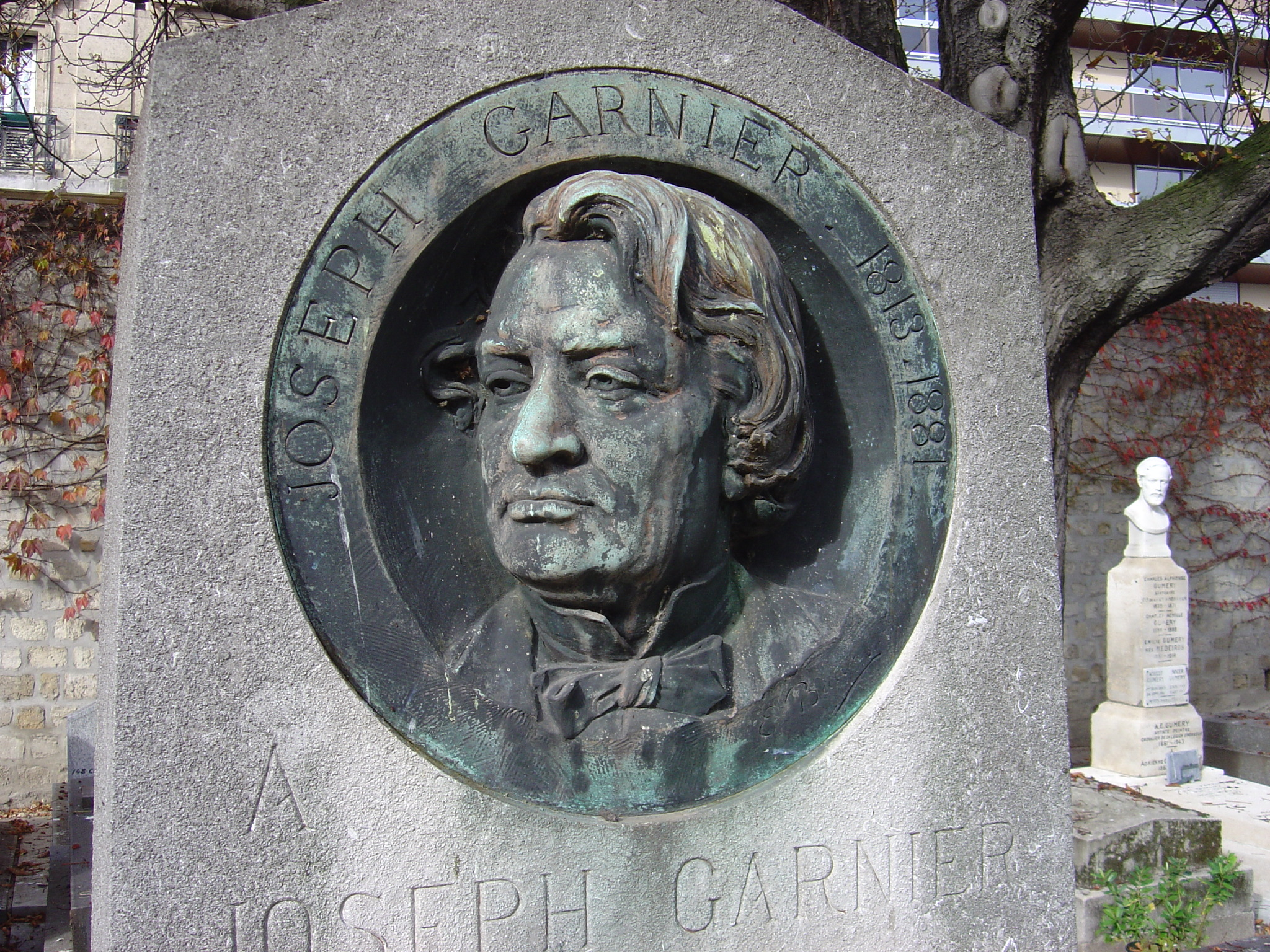 Tomb of Joseph Garnier in the Montmartre cemetery. Relief by [[Louis-Ernest Barrias]]