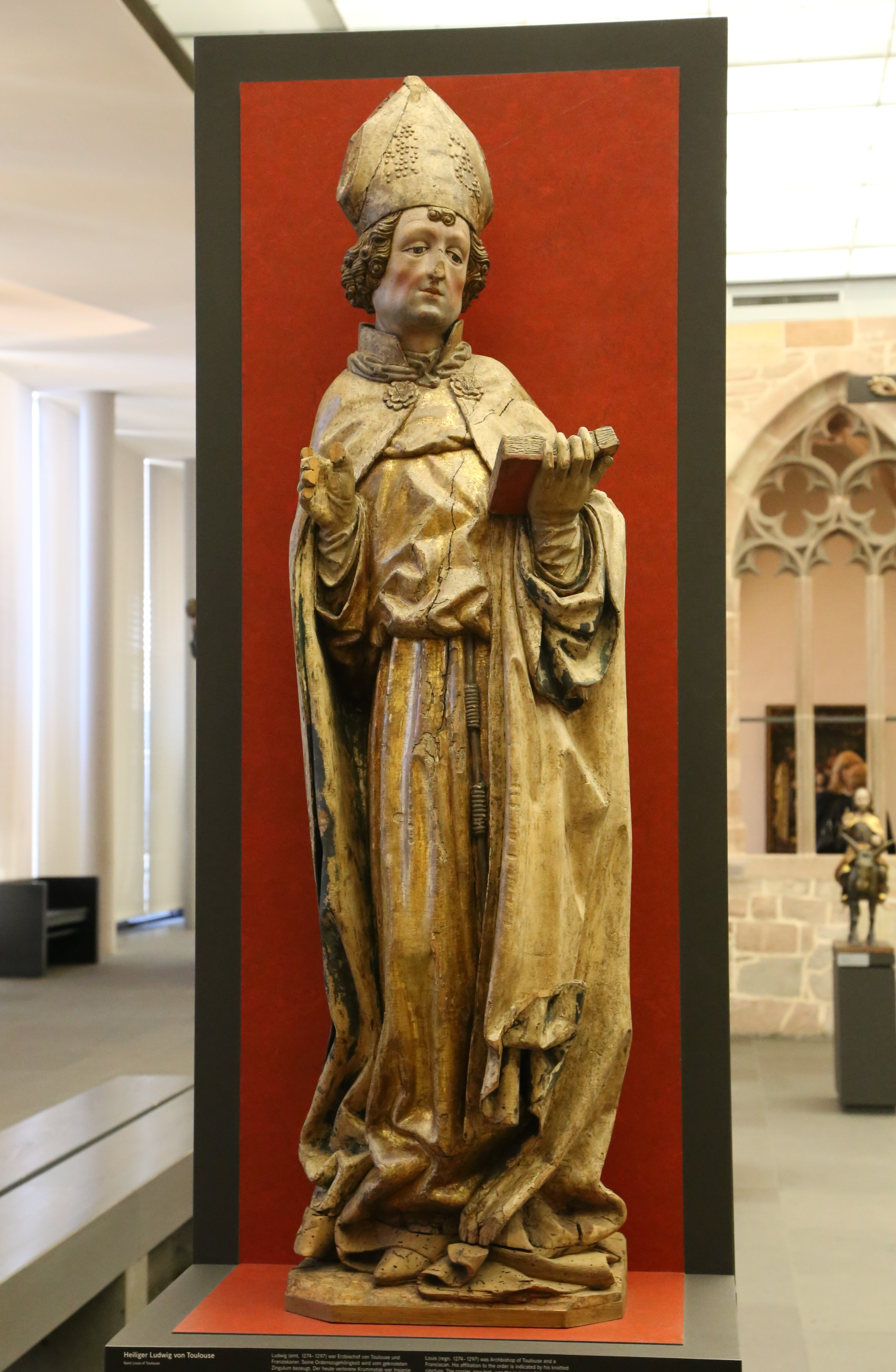 https://upload.wikimedia.org/wikipedia/commons/b/b7/Heiliger_Ludwig_von_Toulouse_Nuernberg_um_1450_Lindenholz_GNM_Nuernberg-1.jpg