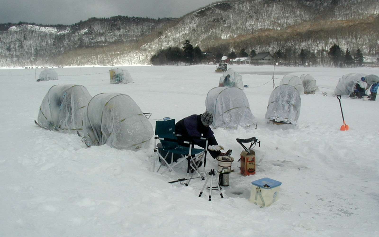 Ice fishing on Ōnuma 001.jpg