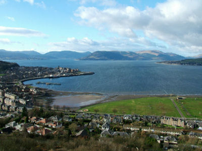 View north west over Fort Matilda and the Battery Park to Gourock and across the Clyde to Strone Point, with the Holy Loch to its left and the mouth of Loch Long on its right, beyond the Rosneath peninsula on the far right.