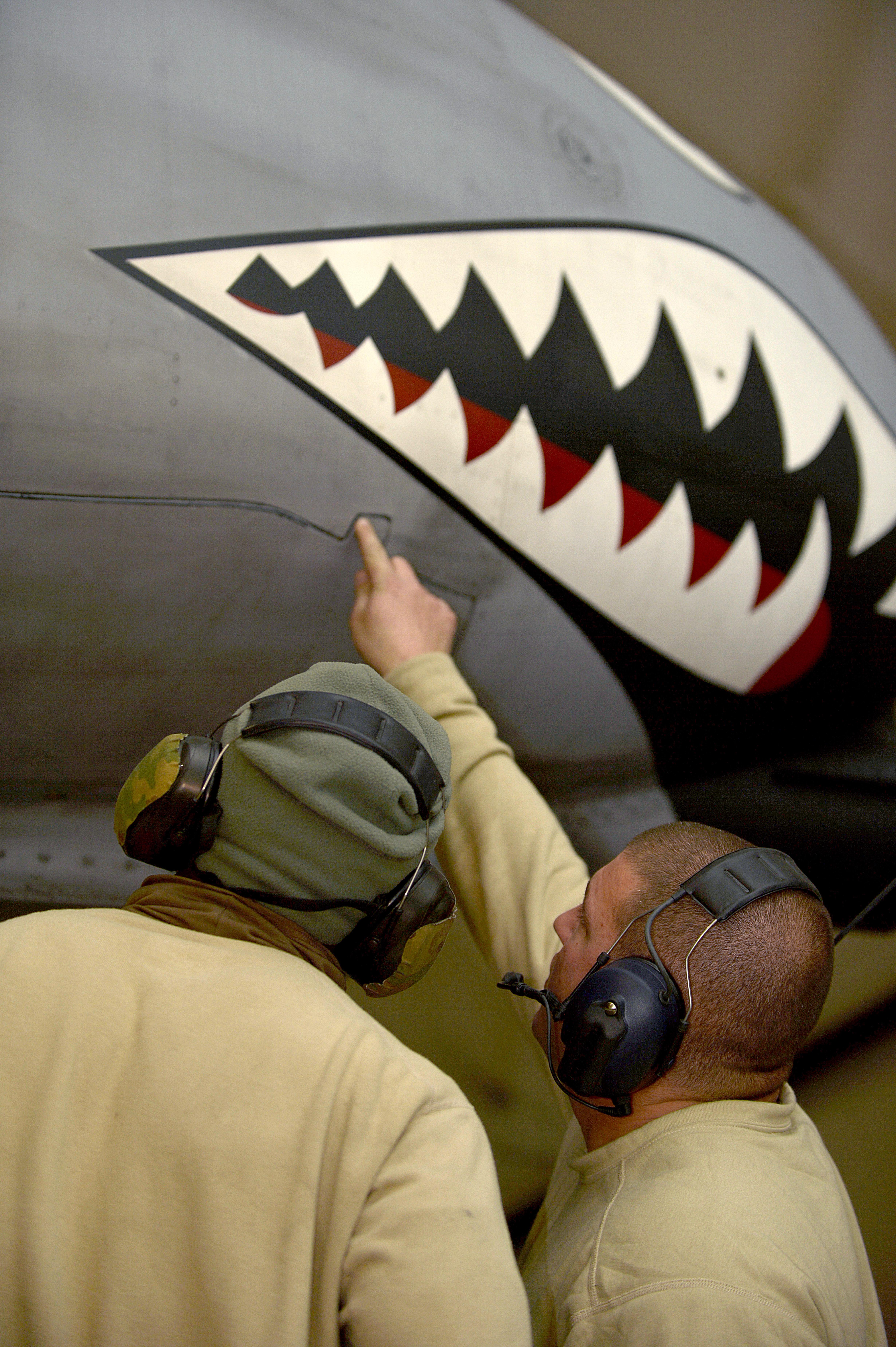 131230 file:u.s. air force senior airman craig irvine, left, a
