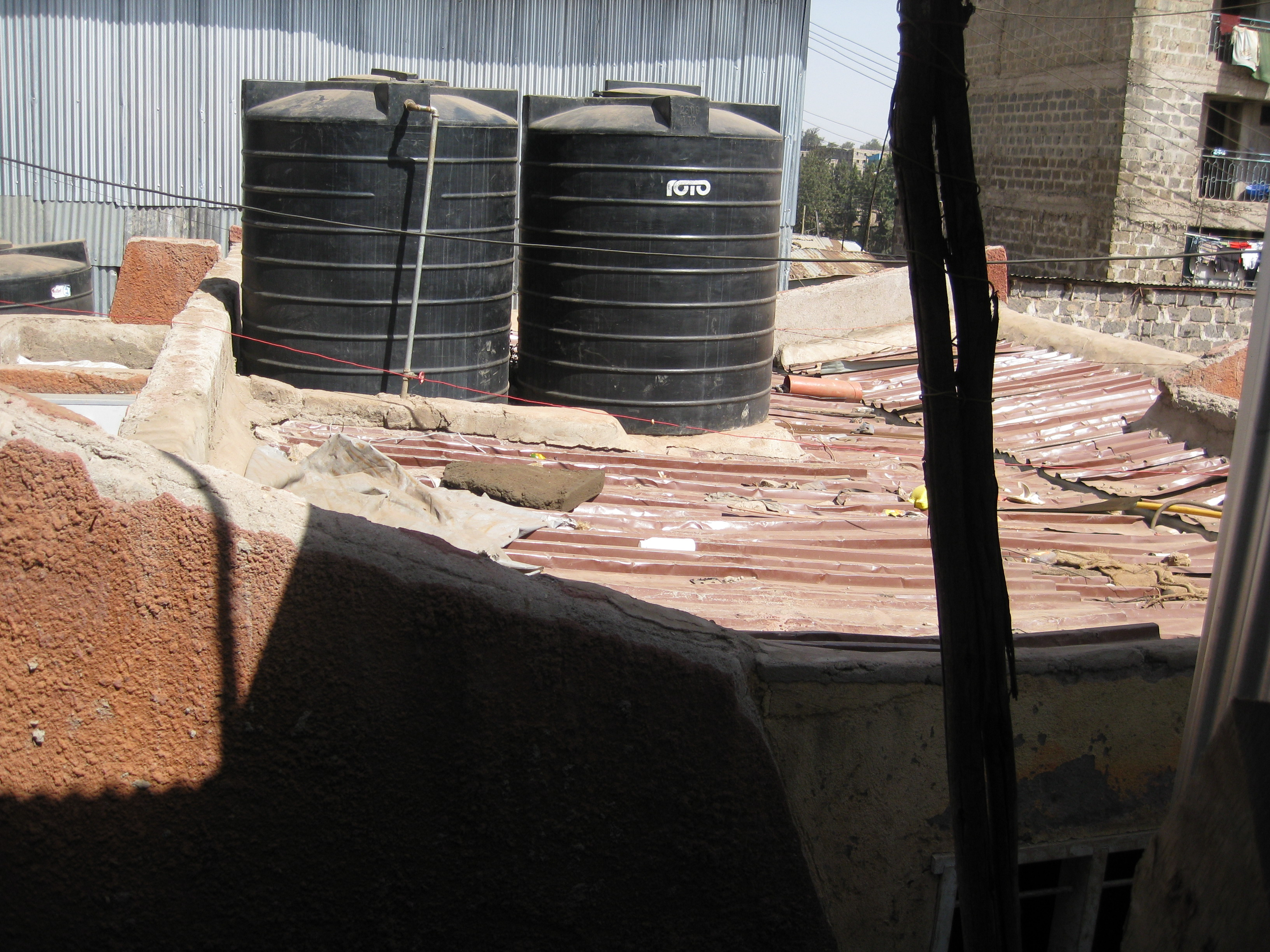 File:Water tanks on the roof of the Ikotoilet in Mathare (6619539027).