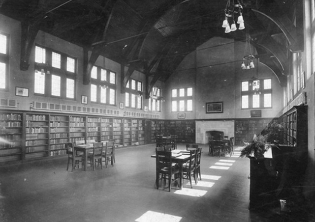Wychwood Public Library interior, Toronto, Ontario.  Note the high windows and full-size bookshelves; Obtained from Wikimedia Commons; Public Domain.