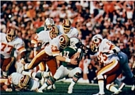 Redskins safety Mark Murphy tackling Dolphins running back Andra Franklin.