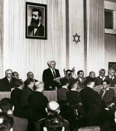 David Ben-Gurion proclaiming independence beneath a large portrait of Theodor Herzl, founder of modern Zionism - History of Palestine