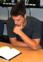 English: Ezra Klein reading a book