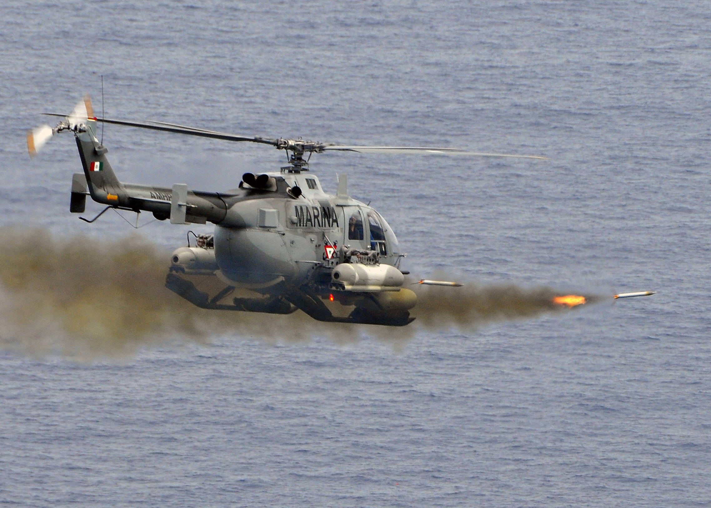 https://upload.wikimedia.org/wikipedia/commons/b/b8/Mexican_BO-105_Bolkow_helicopter_fires_2.75_inch_high-explosive_rockets_at_the_ex-USS_Connolly_(DD_979).jpg