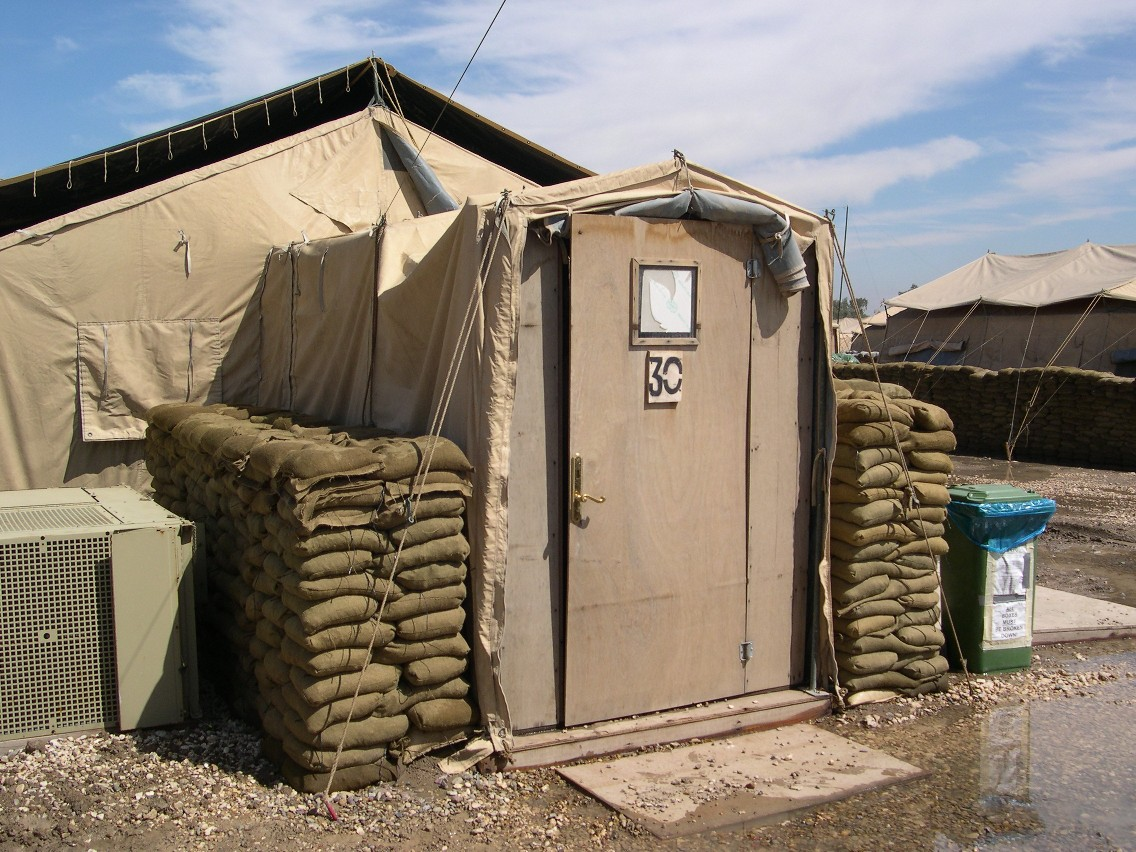Army tent with constructed wooden entrance climate control unit  #386393