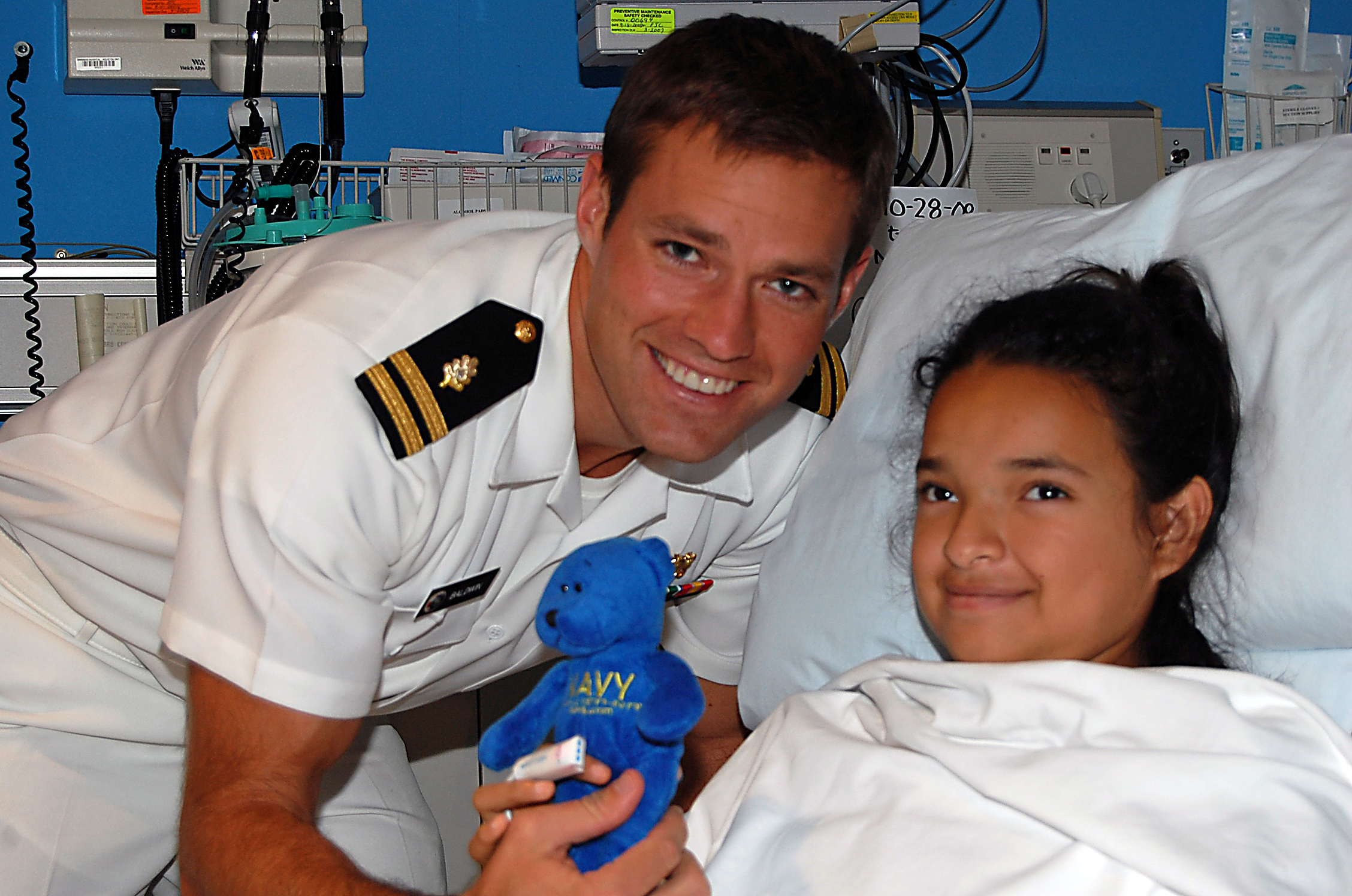 us navy 081106-n-8390s-016 lt. andrew baldwin, m.d., assigned to the navy bureau of medicine and surgery, makes this patient and honorary sailor at shriners hospital houston.jpg