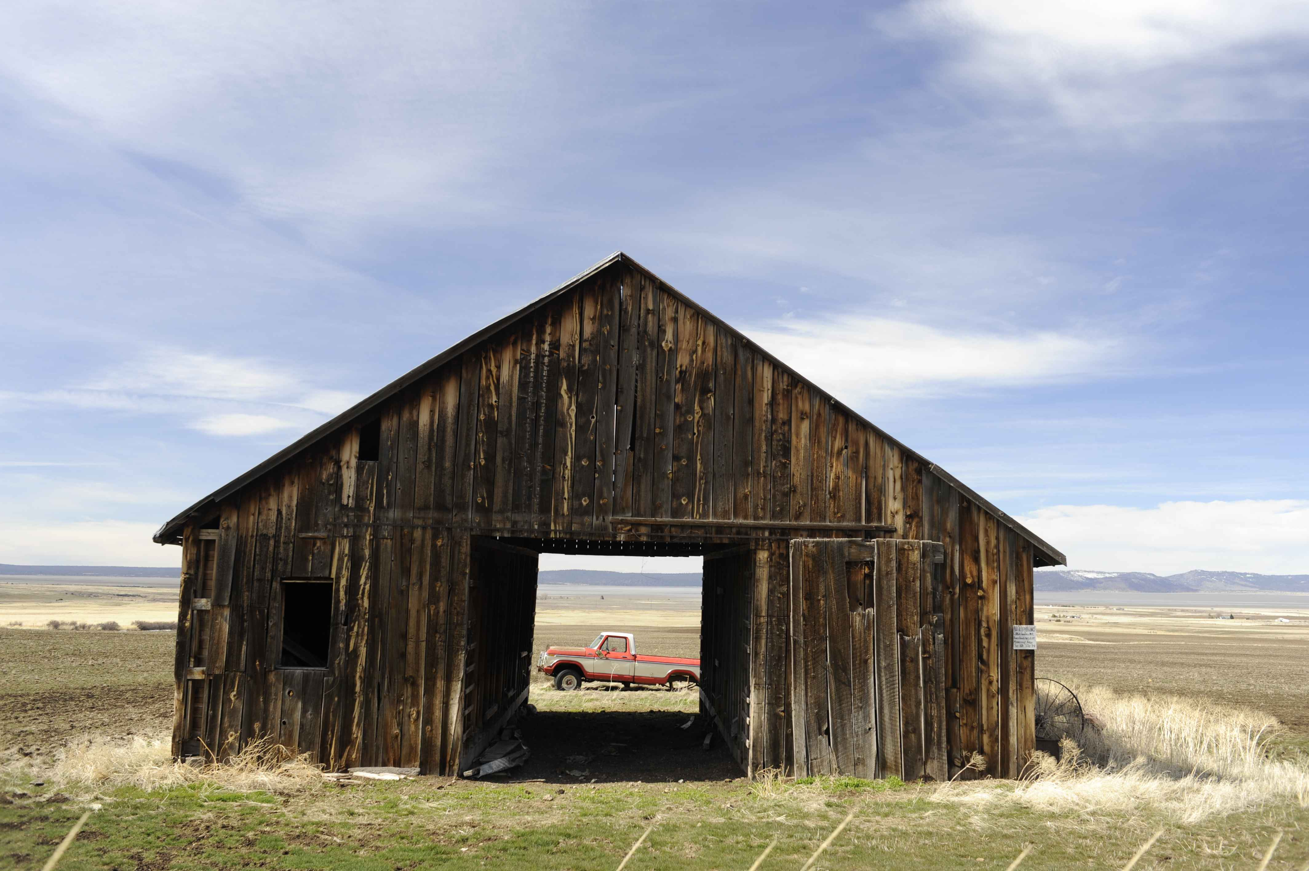 File:View of truck through an old barn.jpg
