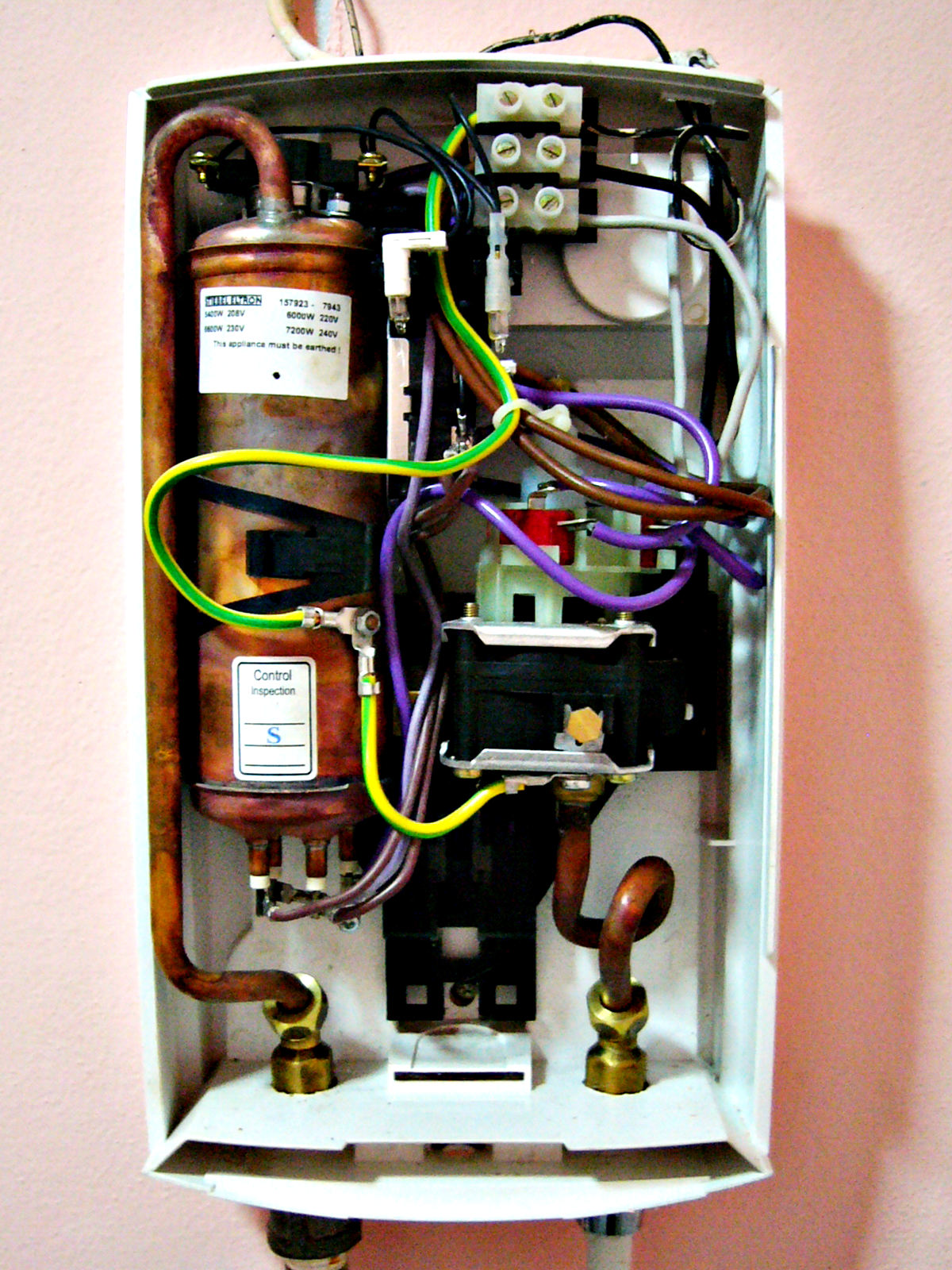 The inside of a hydraulically operated two-stage tankless heater, heated by single-phase electric power.