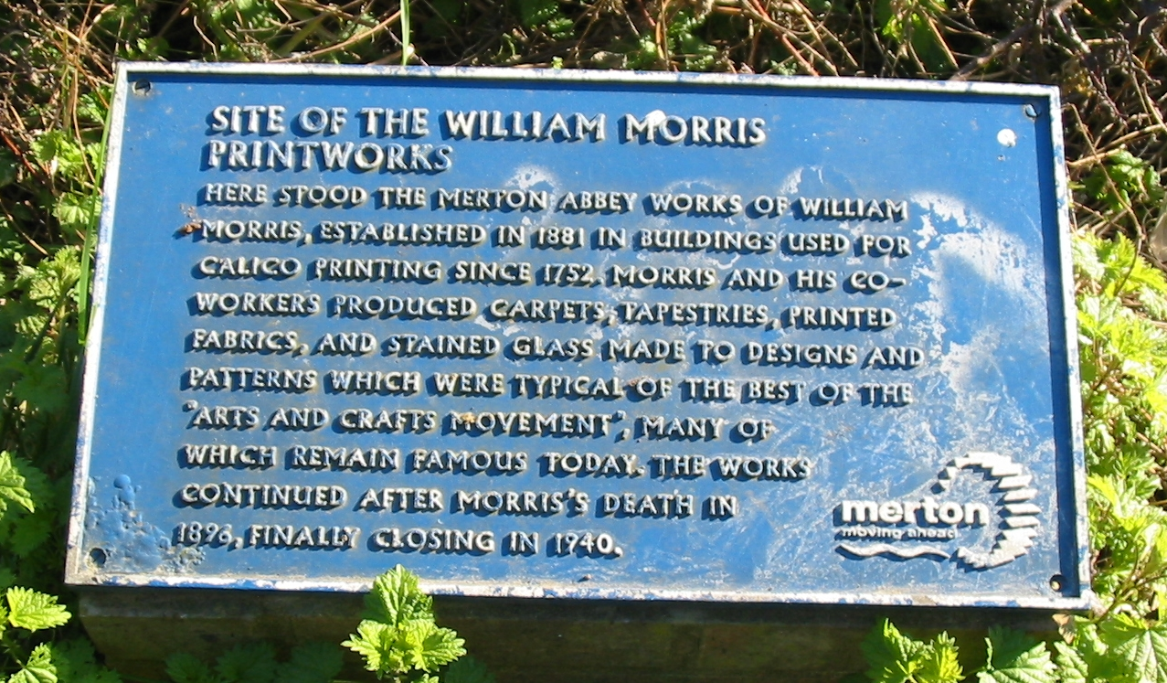 William Morris blue plaque - Site of the William Morris Printworks Here stood the Merton Abbey works of William Morris, established in 1881 in buildings used for calico printing since 1752. Morris and his co-workers produced carpets, tapestries, printed fabrics, and stained glass made to designs and patterns which were typical of the best of the