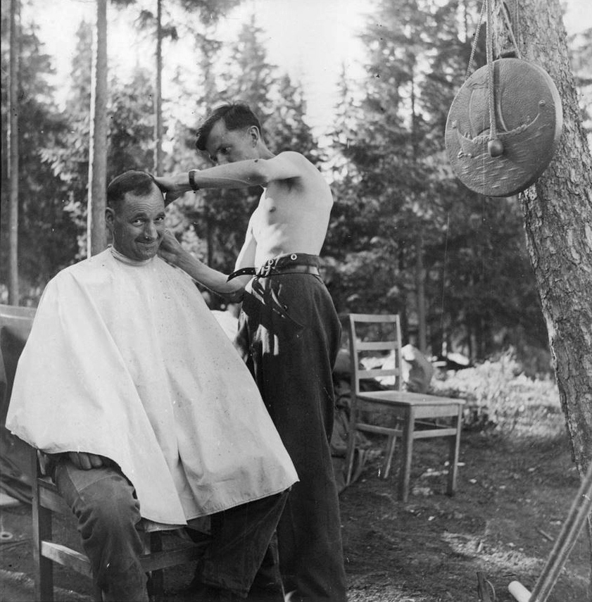 File:A-german-soldier-having-a-haircut-in-a-camp-in-Norway ...