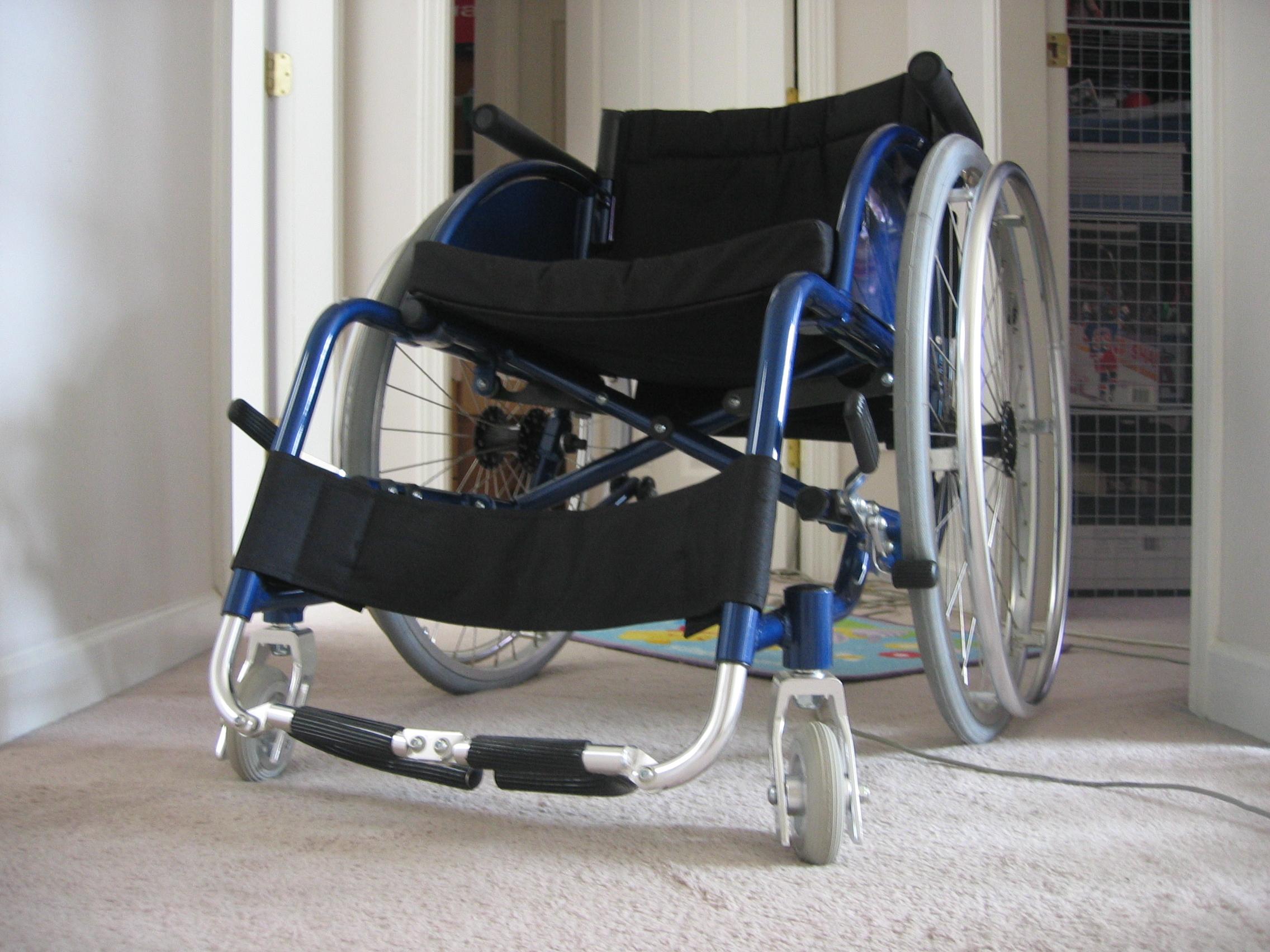 Blue_folding_lightweight_wheelchair