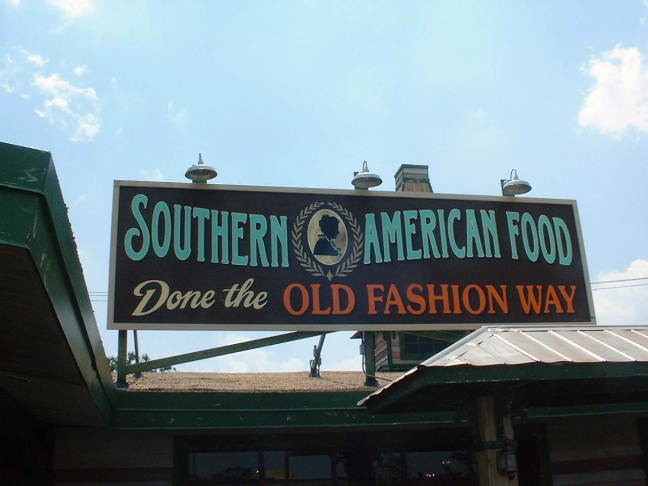 "Large billboard sign saying ""southern cuisine"" at Granny Cantrell's Whistle Stop Café in Pensacola, FL"