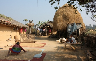 Tharu village near Bardia National Park Tharu village scene.jpg