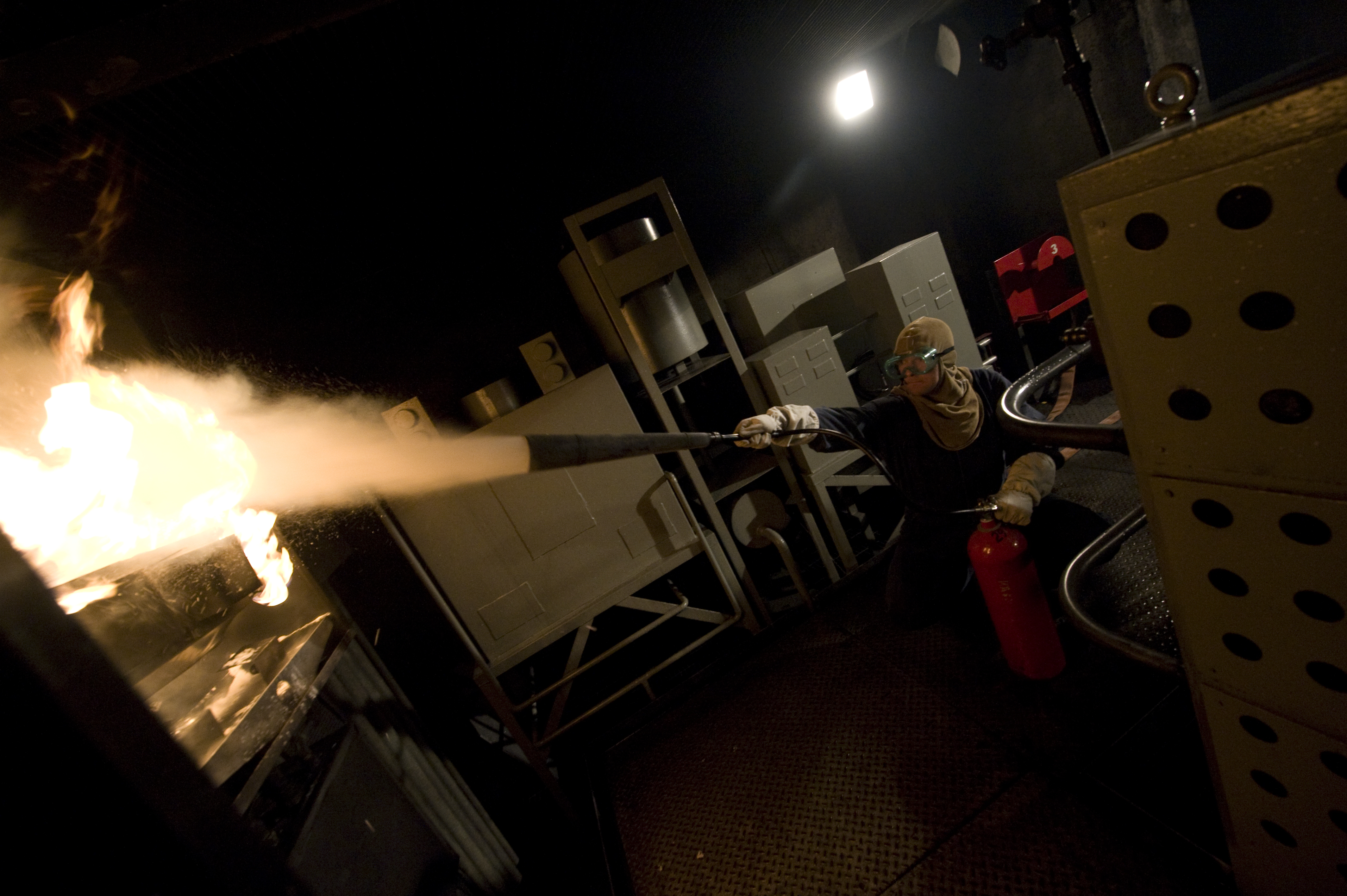 Basic Training Photos >> File:US Navy 100120-N-7090S-340 A student extinguishes an electrical fire using CO2 in the ...