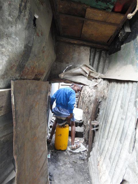 A school girl getting ready to use the urinal (5507167703).jpg English: Kenya - Waterless uni-sex urinals (testing in Nairobi) Date 15 December