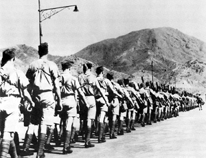 Six weeks before the battle, a Canadian contingent arrives to reinforce the garrison. Canadian Contingent in Hong Kong - 1941.jpg