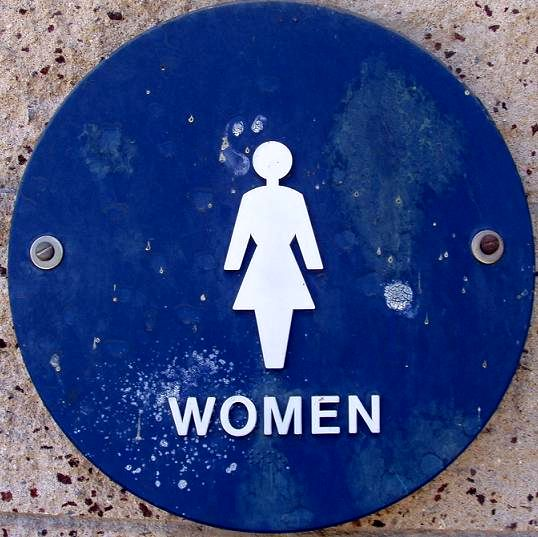 Female symbol on public restroom