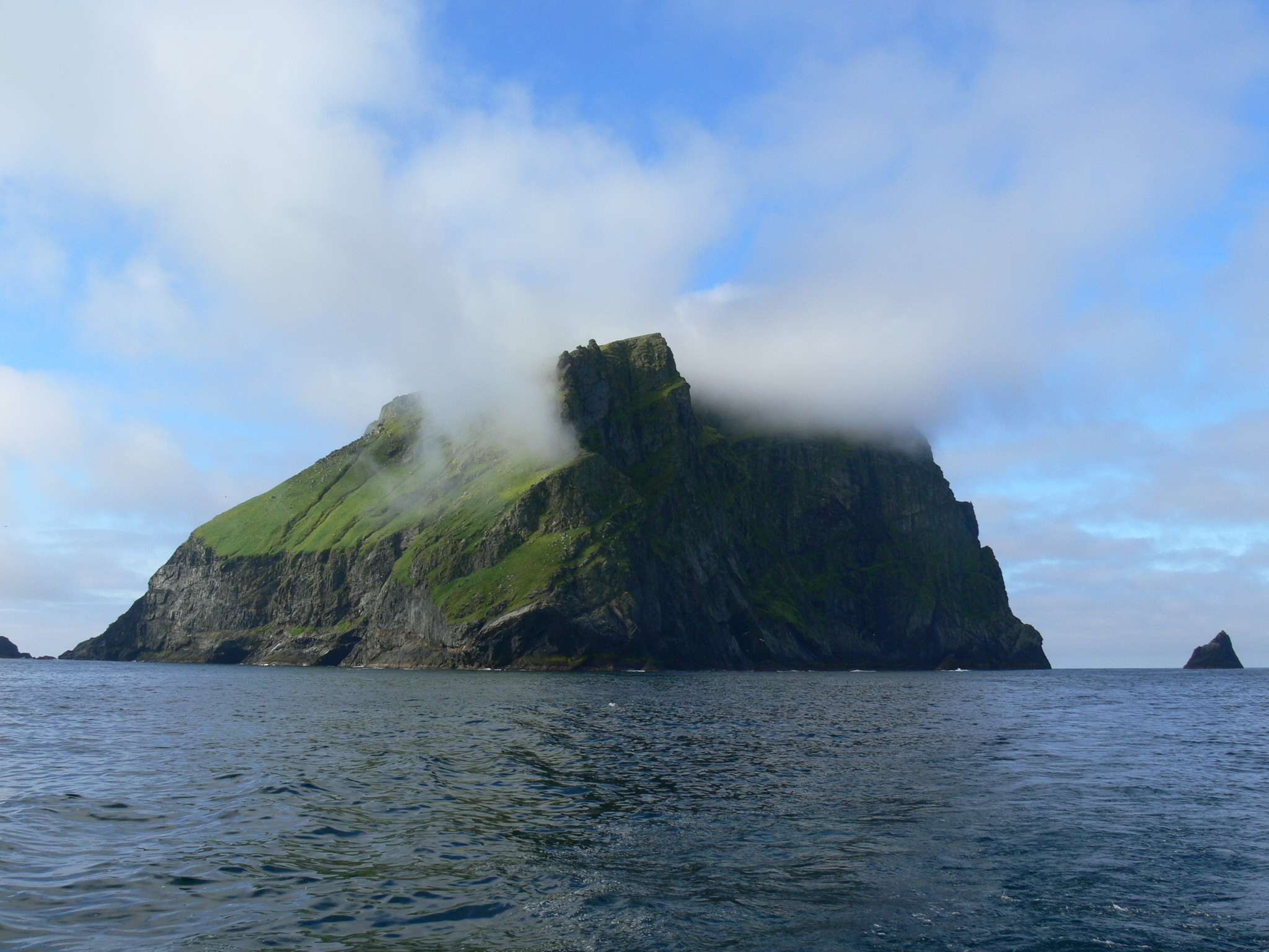 A small rocky island formed from the tip of an ancient mountain rises from the North Sea. Its sides are steep and its top is wreathed in mist. There's a carpet of grass, but no shelter to be seen.