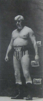 Patterson standing in a corner of the ring.