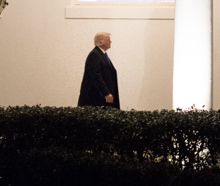 President Donald J. Trump walks down the West Colonnade of the White House (cropped)