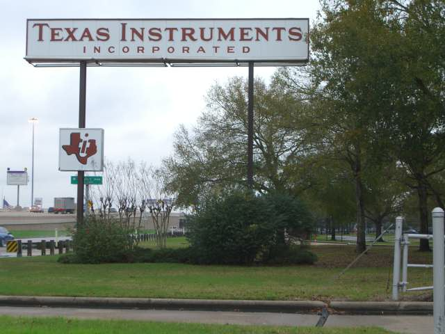 A sign indicating a Texas Instruments facility in Stafford, Texas, near Houston.