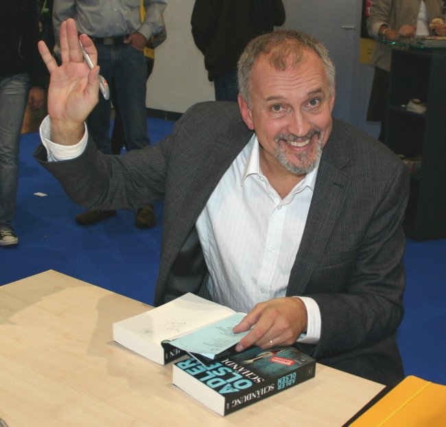 http://upload.wikimedia.org/wikipedia/commons/b/bb/Adler_Olsen_Buchmesse.jpg