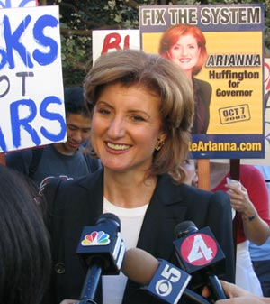 Caption: Arianna Huffington talks to the media...