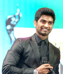 A picture of Atharvaa as he looks at the camera