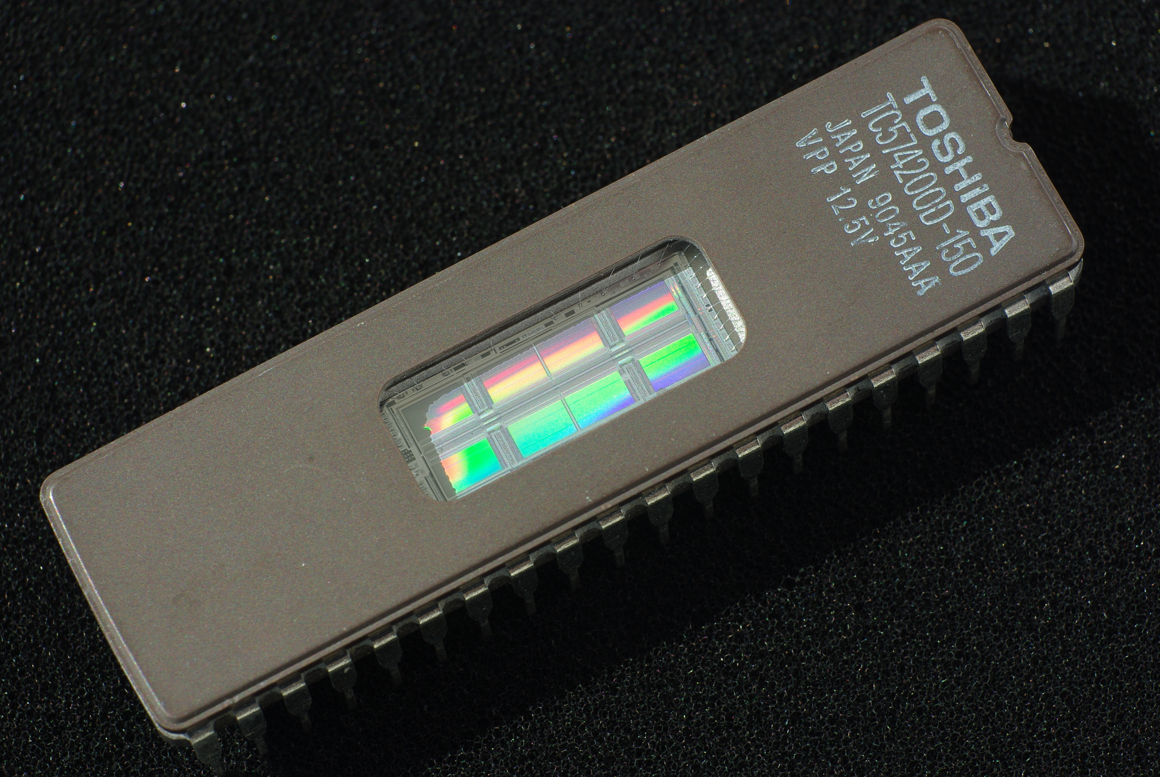 Semiconductor Memory Wikipedia Computer Ram Chips With Binary Code A Circuit Board 4m Eprom Showing Transparent Window Used To Erase The Chip
