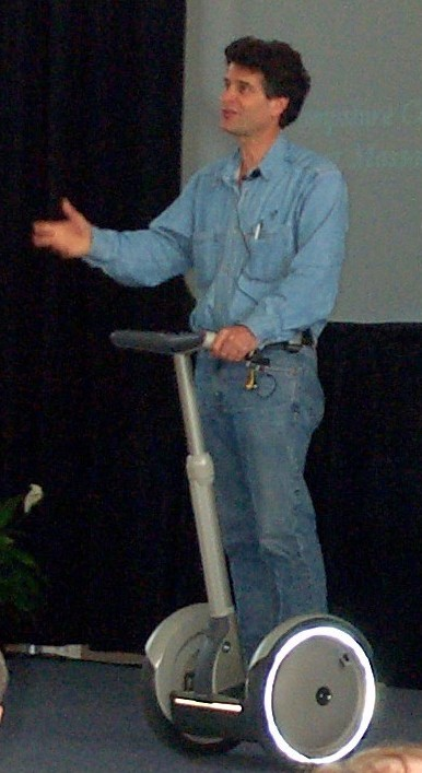Dean Kamen on one of his inventions, the Segway PT.